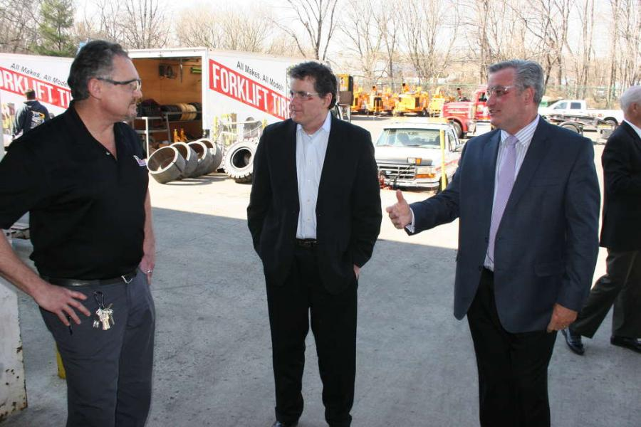 Paul Farrell (C), president and CEO of Modern Group, introduces Congressman Fitzpatrick (L) to John Houser, service technician of Modern Group.