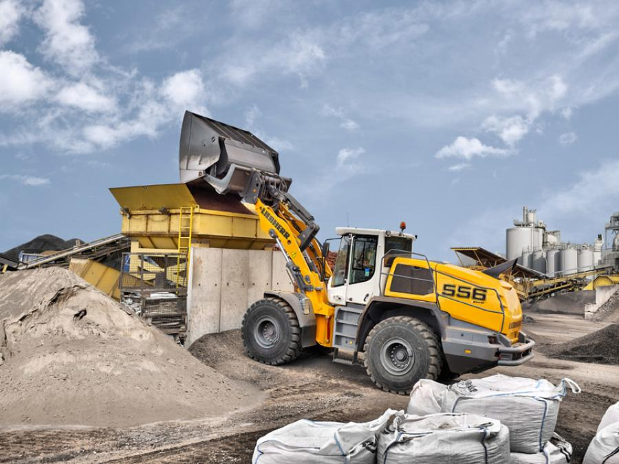 The manoeuvrable and dynamic Liebherr L 556 XPower wheel loader with industrial lift arms and high-dump bucket in test operation at a recycling business.
