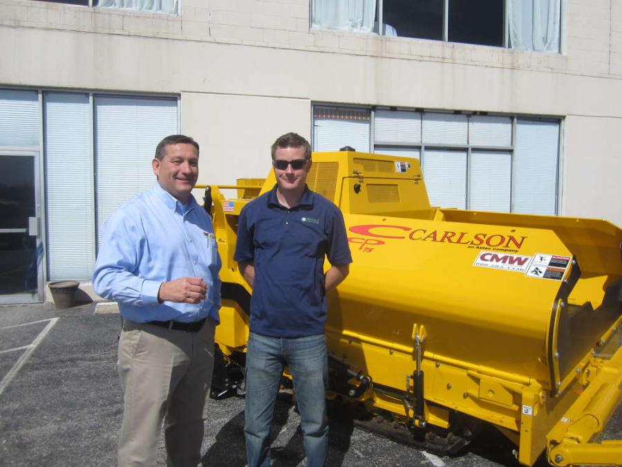 Lee Newton (L), vice president, CMW Equipment speaks with Jesse Stetina of Byrne & Jones Construction about the Carlson CP 75 paver.
