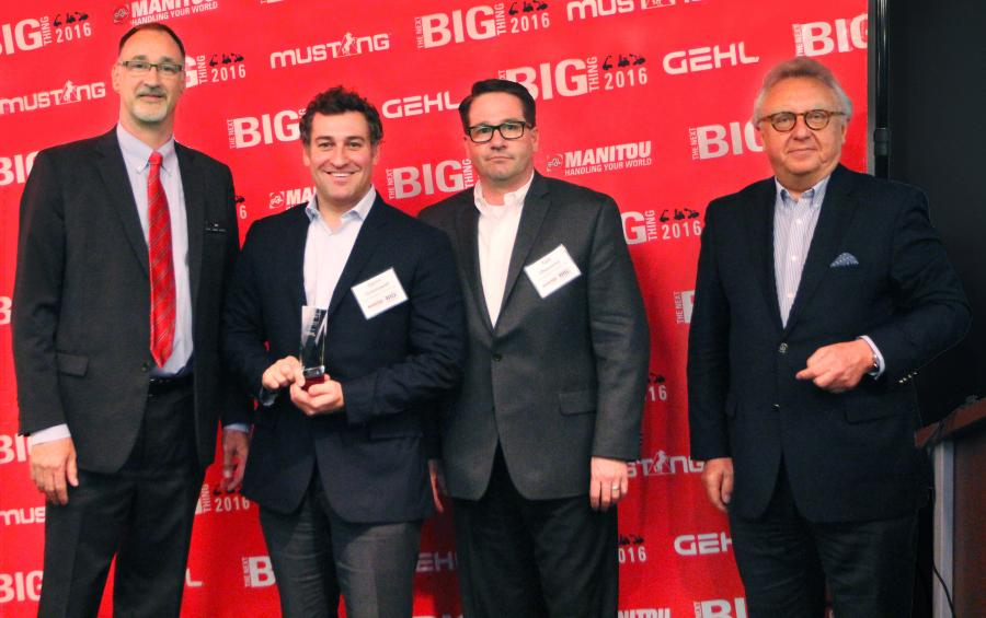 Dan Miller (L), president & CEO of Manitou Americas, and François Piffard (R), executive VP of sales and marketing of Manitou Group, present the 2015 Gehl Top Dealer Award to Darrin Greenawalt (2nd from L) and Tom Champney of Alta Equipment Company.