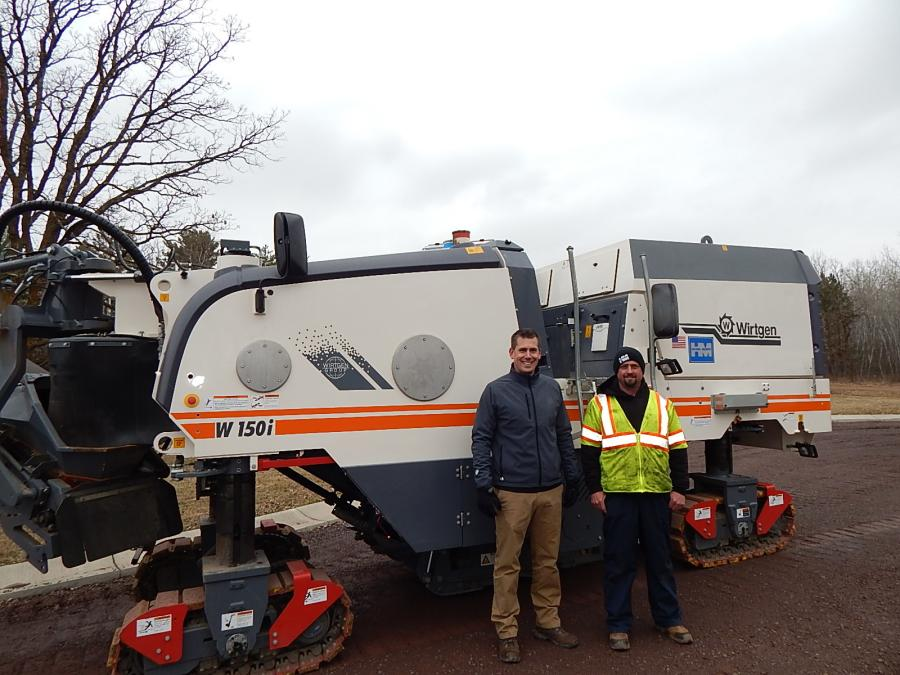 (L-R): Cory Fuhrmann, Wirtgen Americas district sales manager, Chris Maher, Hayden Murphy equipment coordinator, go over the features of this Wirtgen W150i compact cold milling machine.