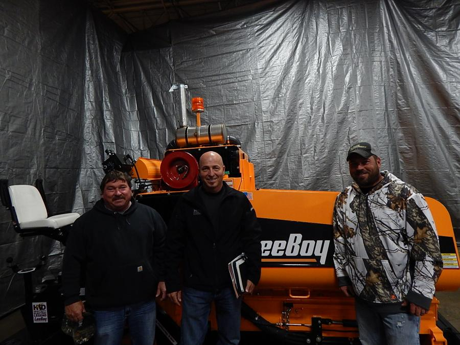 (L-R): Dan Lemke, owner of Lemke Paving, Waterville, Minn.; Jeff Bistodeau, territory sales manager of RMS; and Chris Lemke, Lemke Paving, talk about celebrating Lemke Paving's 37 years in business and adding additional paving equipment to the fleet like this LeeBoy 8515C paver.