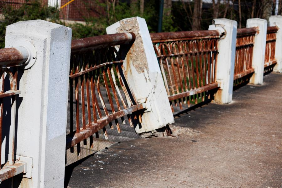 The Northwest Arkansas Democrat-Gazette reported that for the past decade, the north guardrail of the Lafayette Street bridge has bulged out — a deformity incurred when it kept a car from plummeting onto the railroad tracks below.