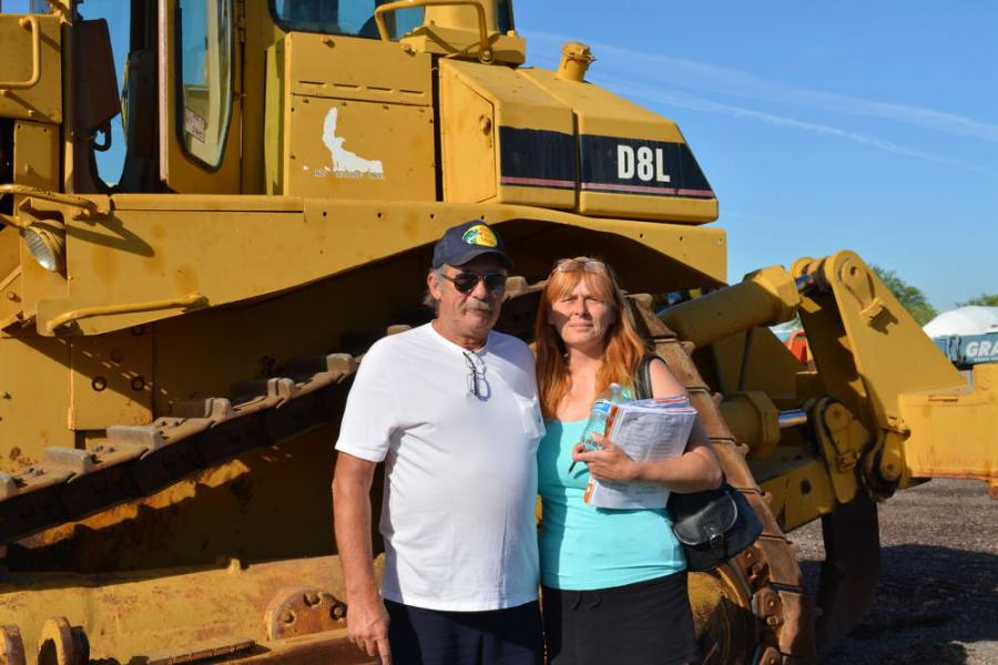 William (L) and Maria Smith of Desert Deco Rock, Searchlight, Nev., were interested in this Cat D8L.