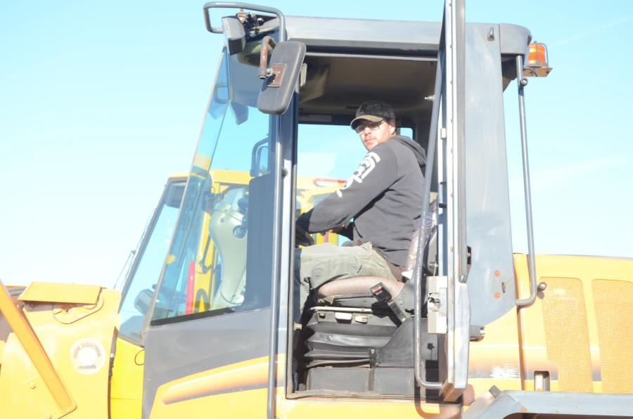 Terry Wilson, a driver for Upstate Idle in Pittstown, N.Y., tests out equipment prior to the sale.
