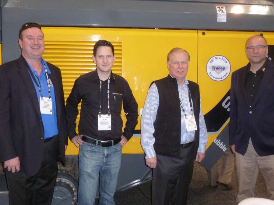 Representatives of RM and its new dealer Tracey Road Equipment, Syracuse, N.Y., pose for a photo. (L-R) are Scott Collins, Tracey Road Equipment; Rene Wagner, RM; Jerry Tracey, Tracey Road Equipment; and Gerald Hanisch, RM.