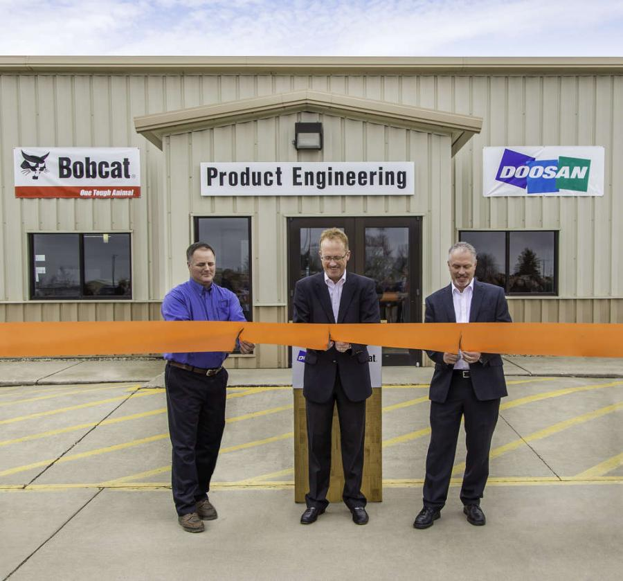 Rich Goldsbury (C), president, Bobcat and Doosan North America and Oceania, recently was joined by Gwinner Mayor Dan McKeever (L) and a member of the Gwinner City Council for a ribbon cutting ceremony at the Gwinner engineering facility. The renovation project is part of an ongoing investment to help enhance work environments, accommodate growth, drive innovation and improve operations across the organization.