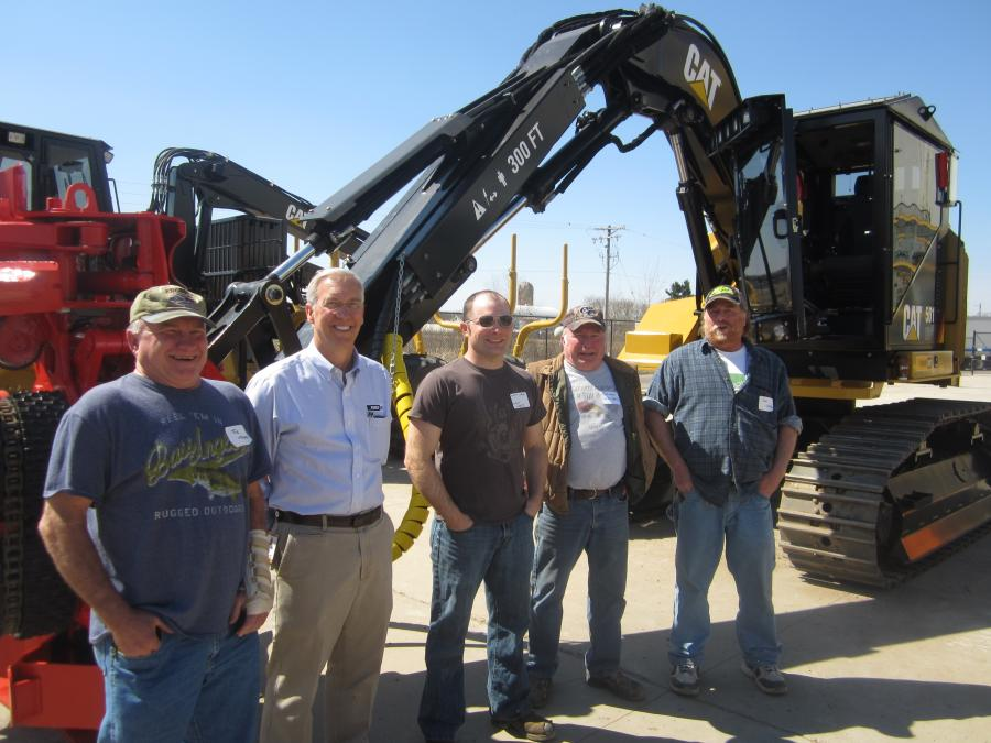 (L-R): Joe Weyer, Weyer Logging; Cory Vrolijk, Fabick CAT; Matt Weyer and Jim Weyer, both of Weyer Logging; and Dan Linder, town of Loyal; stand in front of this Cat 501HD processor equipped with a PF-48 processing head.