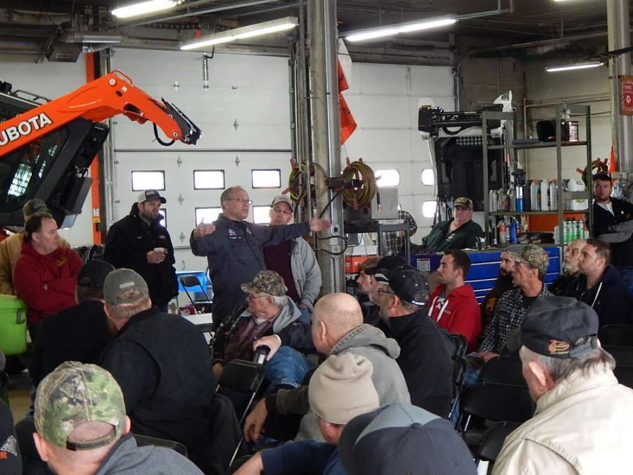 The state patrol seminar on equipment load and trailer safety on Minnesota roads garners attention from the attendees.