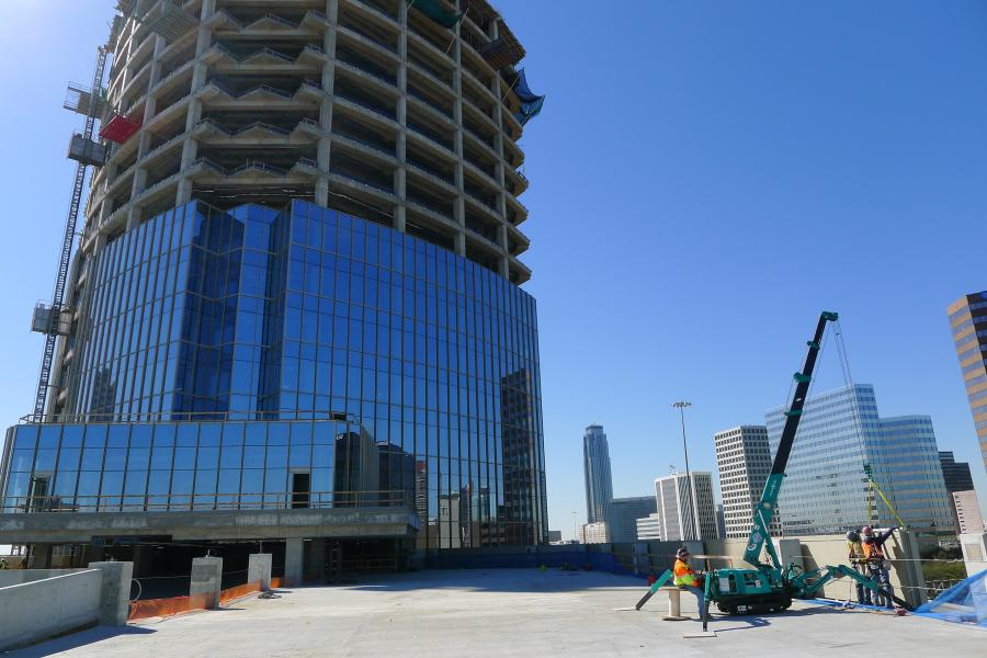 A Maeda MC285 was utilized by a glass and curtain wall company to hoist and install unitized glass curtain wall panels on the exterior of AMEGY Bank's new Houston headquarters.