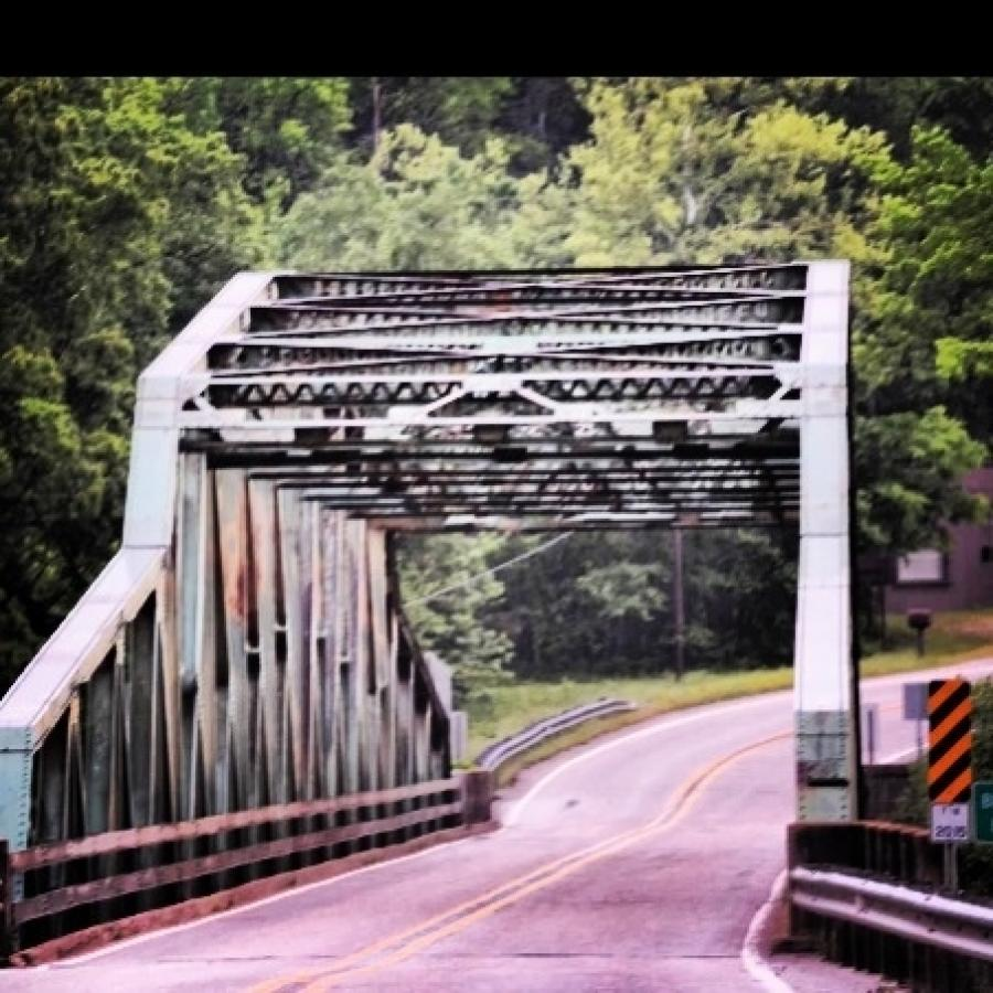 Rust is slowly replacing the faded green paint on an 85-year-old bridge over the Buffalo National River. (Pinterest)