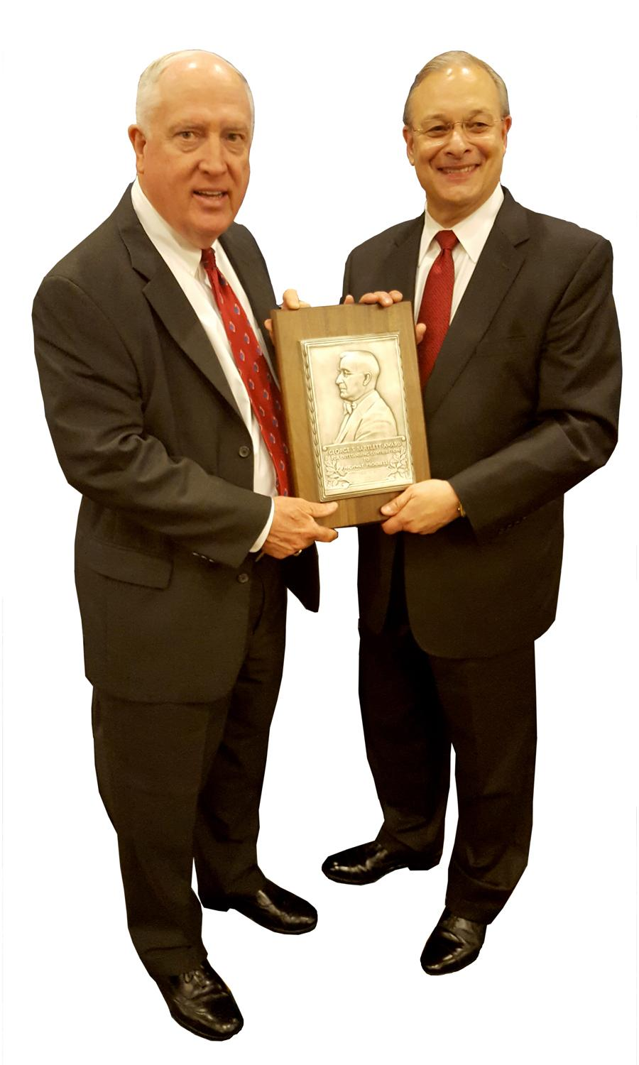 David Gehr, senior vice president and highway market leader at WSP | Parsons Brinckerhoff (right), receives the George. S. Bartlett Award from Pete Ruane, president and chief executive officer of the American Road & Transportation Builders Association