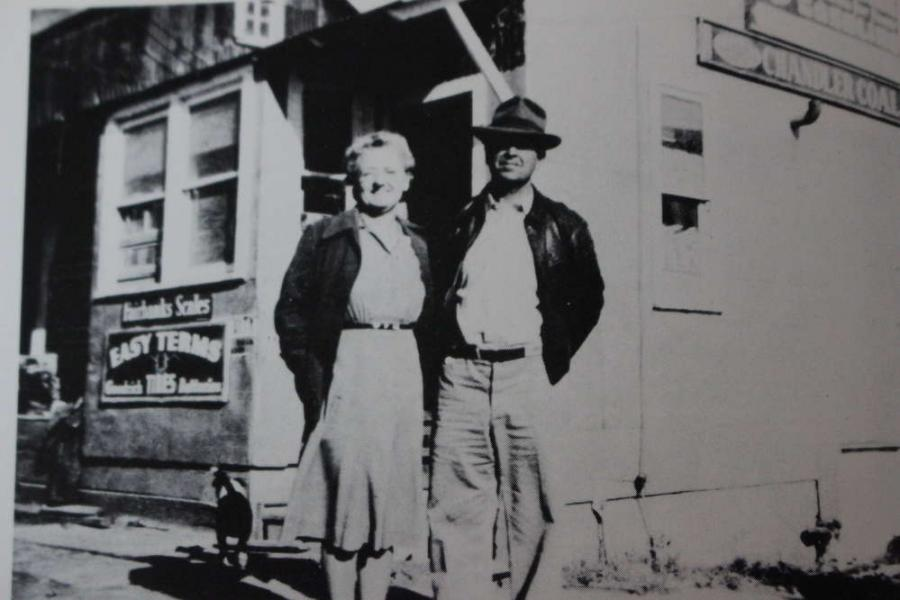 I.R. and Bessie Romer in front of Romer Merchantile.