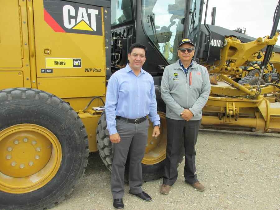 Edgar Sierra (L) and Mario Escobedo of Sika Construction in Monclova Coah, Mexico, are ready to take this Cat 140 M motorgrader home with them.