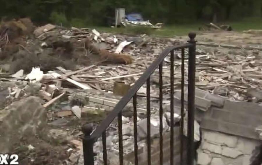 Image courtesy of FOX2. Detroit News affiliate FOX2 is reporting that a local builder known for putting up million-dollar homes is to blame for a lot filled with debris, rotting wood and construction materials