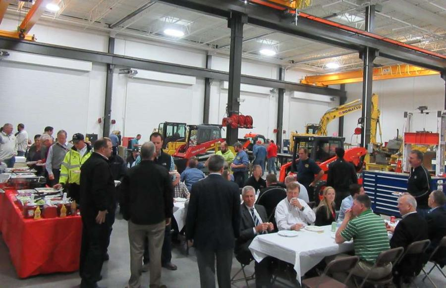 Columbus Equipment Company employees and customers line up for