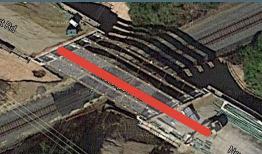 Image Courtesy of Google Earth.The website Delaware Online is reporting that in 2011, the Delaware Department of Transportation spent more than $5 million to rebuild a bridge overpass near Newport to accommodate taller freight trains.