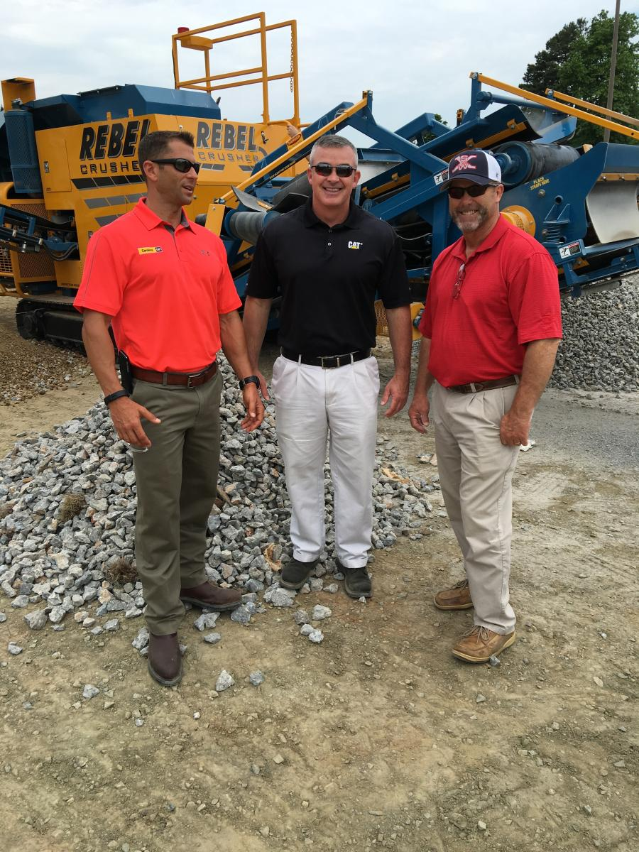 (L-R): Will Wood and Tony Pennington, both of Carolina CAT, and Wes Bradley of Draw Enterprises in Charlotte, talk about the uses of the product produced by the Rebel Crusher.