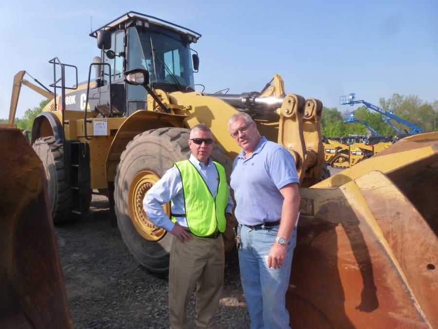 Joe Villa (L), used equipment manager, Ransome CAT, and Scott Cornell of A H Cornell & Son Inc., Jamison, Pa. Cornell purchased two Caterpillar 980K wheel loaders at the Ransome One-Day Sale.
