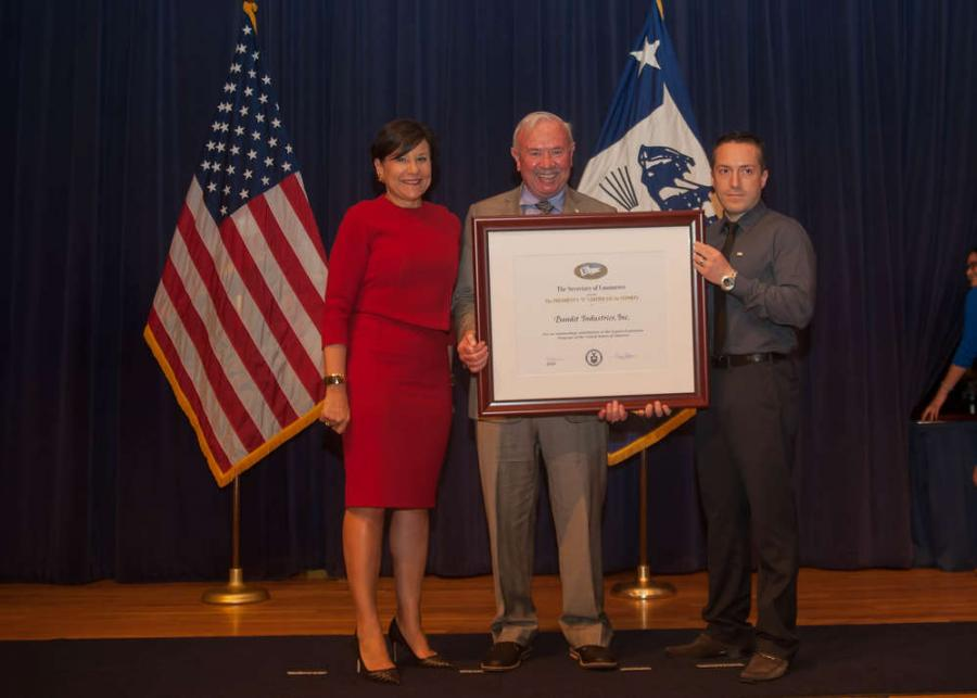"Jerry Morey (C), Bandit president, along with Felipe Tamayo (R), international sales manager, were presented the President's ""E"" Award for Export by Secretary of Commerce, Penny Pritzker."