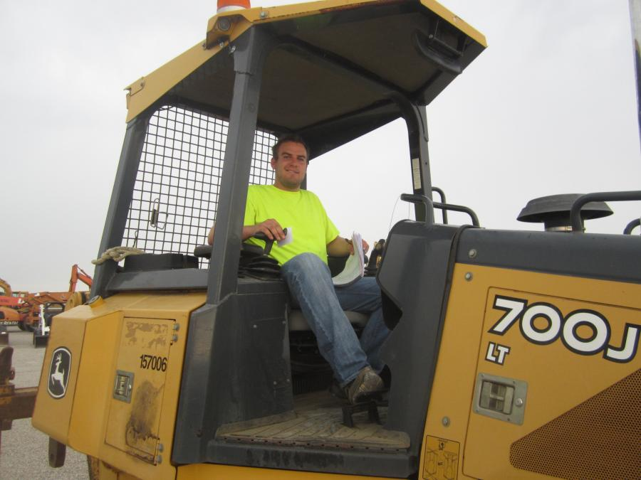 Aric Geurink, H.E.S. Equipment, tries out this John Deere 700J dozer.
