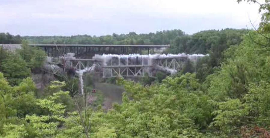 Two and a half million pounds of steel rained down into Cattaraugus Creek on Thursday morning when 35 pounds of explosives took down the span the old Route 219 bridge.