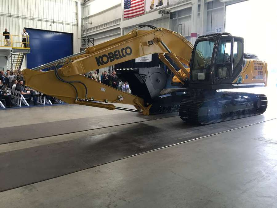 "The very first Kobelco SK210LC makes its grand entrance.  It's a 49,500 pound machine that usually comes with a 42"" or 48"" bucket.  It can also handle a wide range of attachments including hammers, shears, grapples, processors, pile drivers, magnets, generators & more."