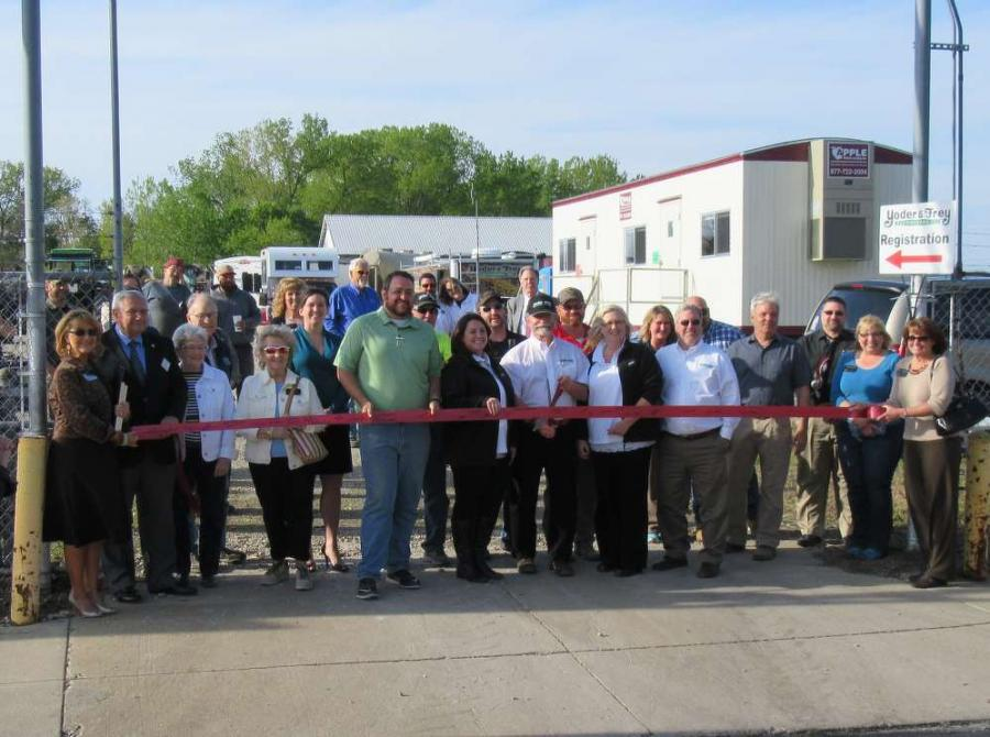 Peter Clark, Yoder & Frey owner, cuts the ribbon to mark the first annual Ashland, Ohio, spring auction.