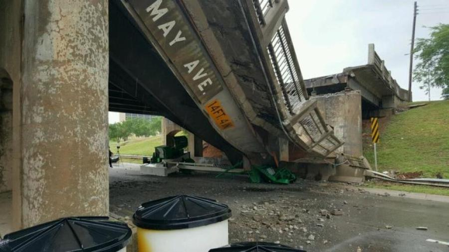 Most of a 52-foot-long section of the bridge's northbound lanes fell May 19 after being struck by a truck hauling a boom lift. Image courtesy of KFOR.