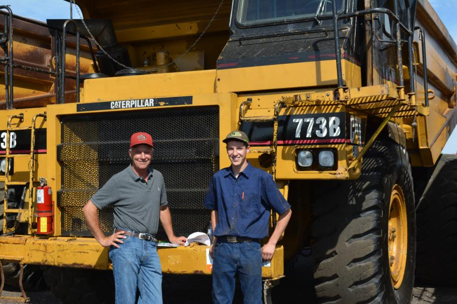 Mike Denny (L) and Calvin Denny of MDI Rock were looking for a rock truck like this Cat 773B. MDI has locations in Phoenix and Prescott, Ariz.