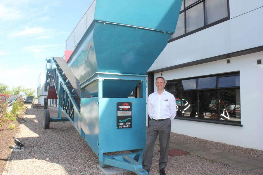 Colin Clements, global product line director, beside a 1966 MK1 screening machine. This was the sixth machine built and remains a permanent feature at the front of the Dungannon plant.