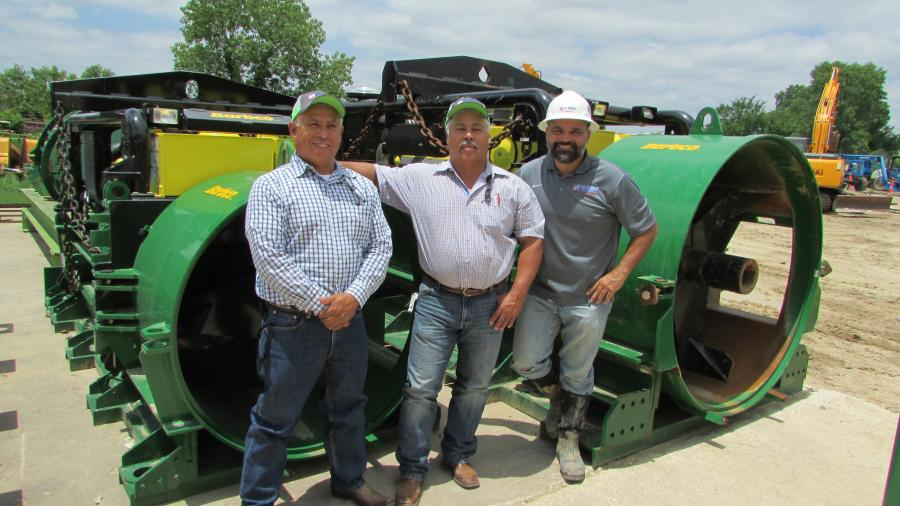 (L-R): Arturo and Robert Rubio of Qro Mex Construction Co., Granite Shoals, Texas, pose with Chad Pendley, national sales representative of U.S. Shoring & Equipment Co., Euless, Texas, and the 60/1.2M Barbco auger/boring machine (ABM).