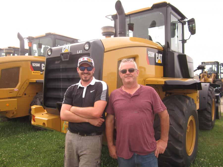 Sean (L) and Jack Maloney, both of Merc Group LLC, stand in front of this Cat 926M wheel loader.