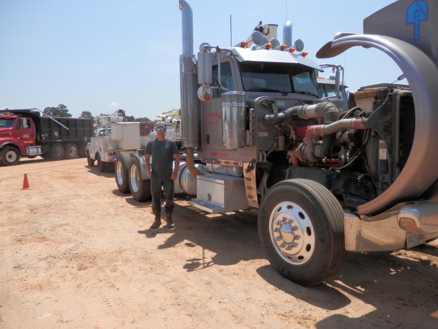 Logan Cumbest, Coastal Disposal Land Services, Lucedale, Miss., inspects one of the truck tractors in the early Fall public auction.
