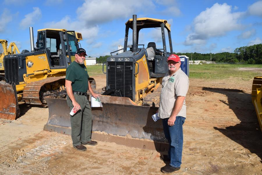Jeff Holton (L) and Brian Crossland hope to find a dozer.