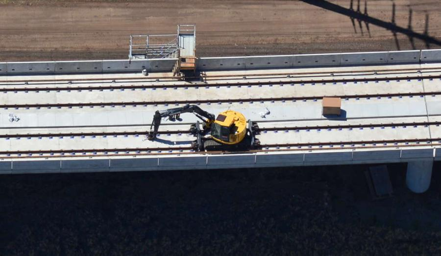 Honolulu Transit photo. Rail tracks are laid on the guideway that runs parallel to Kualakai Parkway between the East Kapolei station and the West Oahu station.