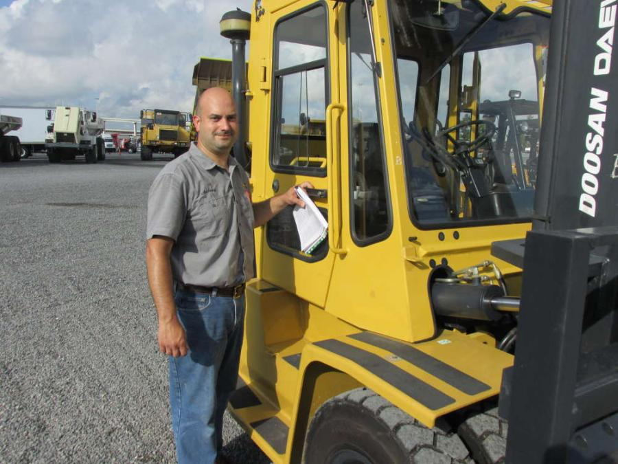 Anthony Garmon of Superior Lift in Stevens, Pa., has spent a lot of time checking out this Doosan D70S rough-terrain lift truck.