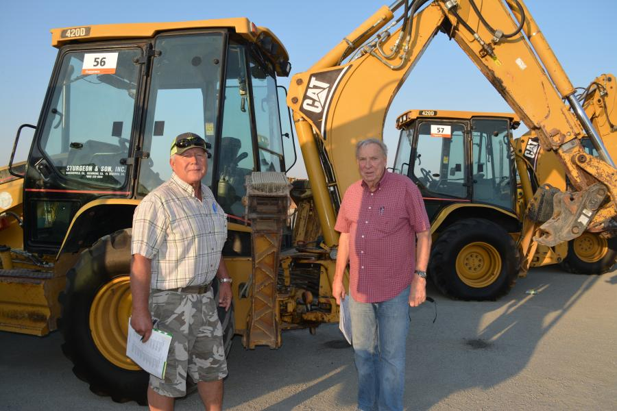 Lance Madgwick (L) of Boise, Idaho, and Russ Yensen of Laguna Beach, Calif., were on hand for the auction. Both showed interest in this Cat 420D.