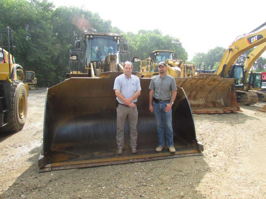 Barry (L) and Jon Baker, A-Del Construction, Newark, Del., attend the sale.