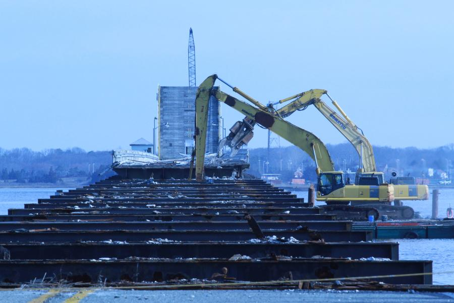 Komatsu excavators perform demolition.