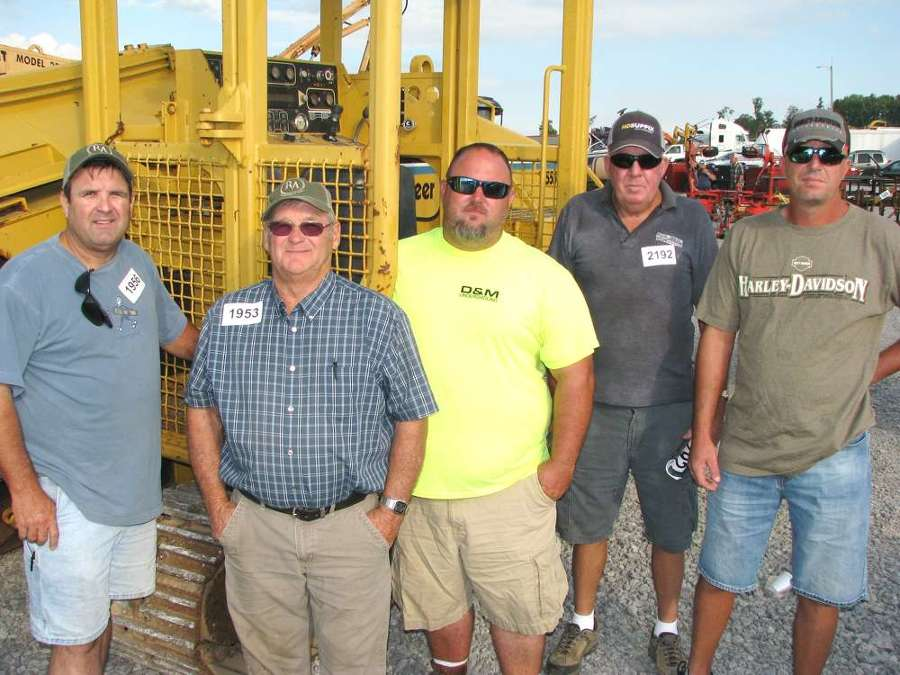 (L-R): Rodney (L) and Ronnie Lockhart, Lockhart Trenching & Boring, Rock Island, Tenn.; Brian Smith, D&M Underground, Shelbyville, Tenn.; and Curtis and Nick Williamson, Williamson Construction, Murfreesboro, Tenn., look over equipment at the sale.
