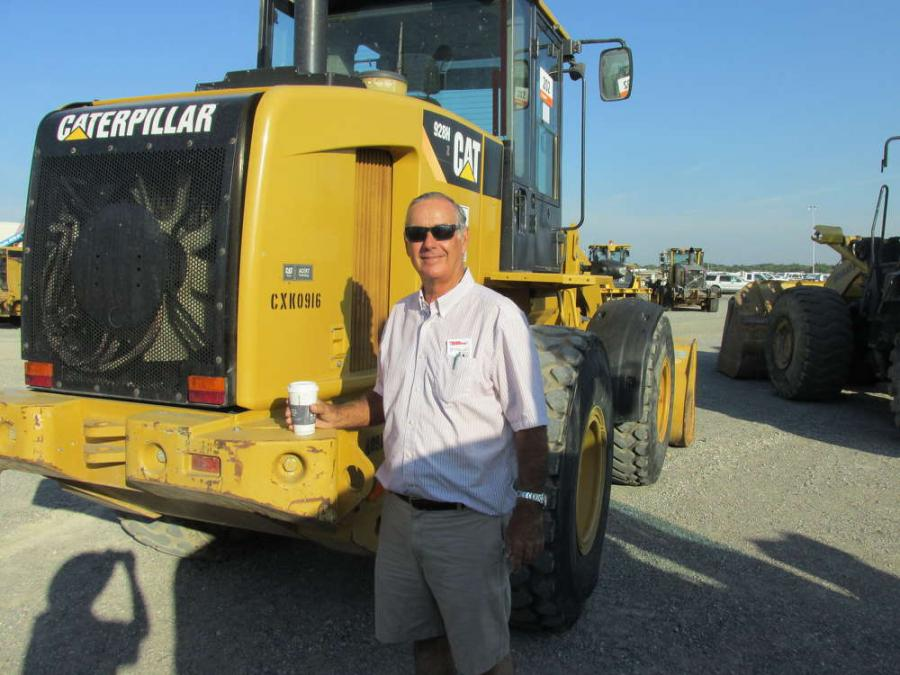 Leslie Cain, Cain Services in San Marcos, Texas, checks out this Cat 928H loader.