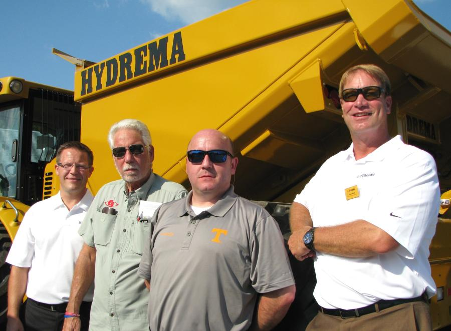 (L-R): Kris Binder, Hydrema U.S.; Tom Schnackenberg, Curry Supply Co., Martinsburg, Pa.; Steve Woodby, Power Equipment Co., Knoxville, Tenn.; and Barry Farrell, Hydrema U.S., talk about the versatility of Hydrema trucks.