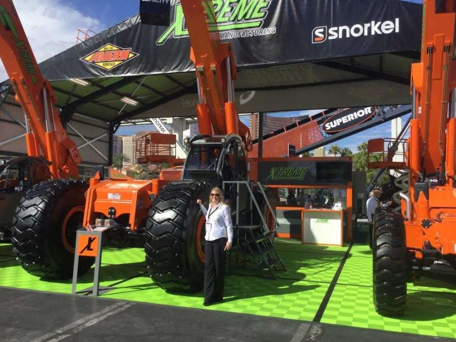 Amelia Pearce, global marketing director of Ahern Rentals, Las Vegas, Nev., displays the latest high-reach equipment.