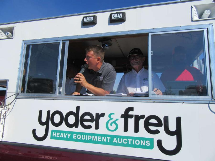 Auctioneer Andy White (L) keeps the bidding moving as Peter Clark, Yoder & Frey Auctioneers president, keeps an eye on the sale.