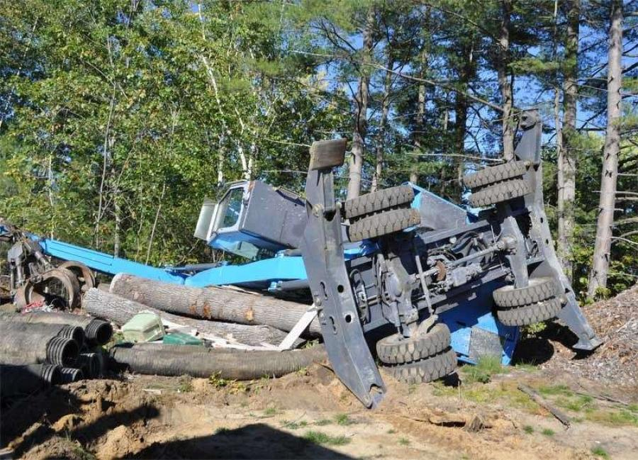 Image courtesy of the Bow, New Hampshire police department.  gt. Arthur Merrigan said when police arrived at 3 p.m., Peter Emanuel of Bow had already used the front-end loader to tip over another piece of construction equipment occupied by the victim.