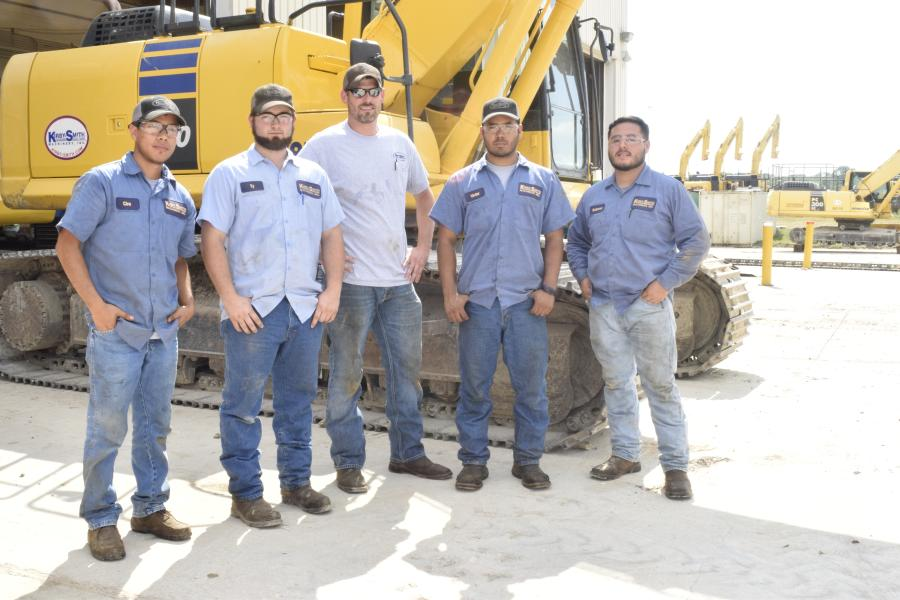 (L-R): Texas State Technical College in Waco DET graduates Ciro Suaste of Italy, Texas; Ty McCarver of White Settlement, Texas; Rick Adam of Granbury, Texas; Victor Membreno of Brenham, Texas; and Rodrigo Gutierrez of Ennis, Texas, stand in the maintenance yard at Kirby-Smith Machinery Inc. in Dallas. KSM hired by the alumni this year to train and work as service technicians.
