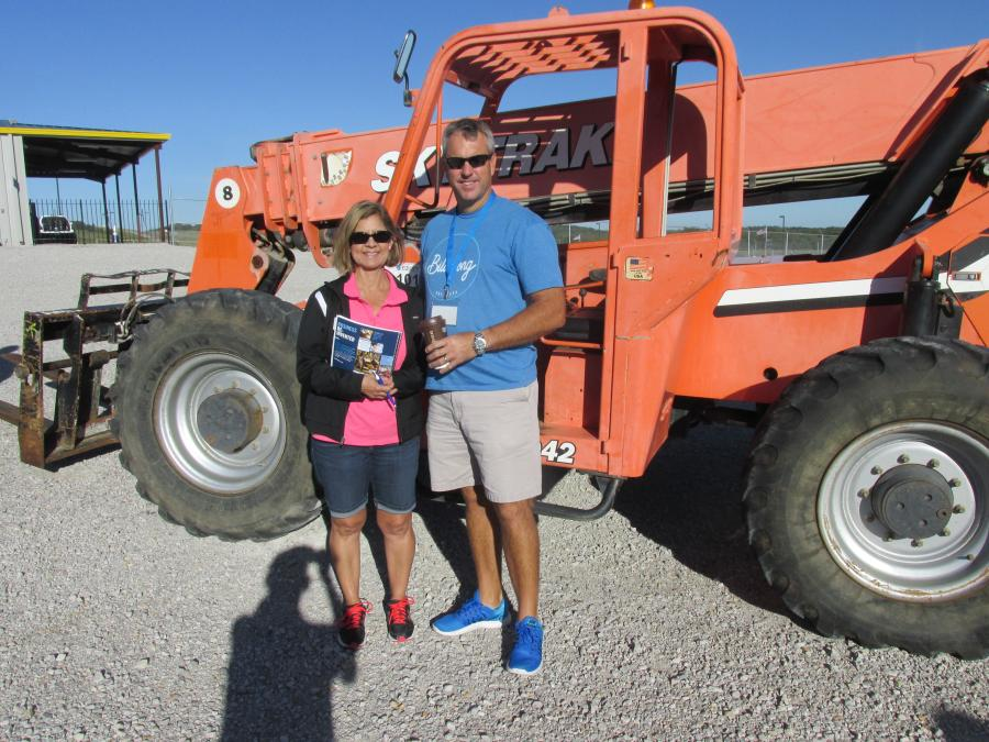 Norma (L) and Alan Cockerham, owners of Carnival America in Ft. Worth, Texas, are looking at this JLG SkyTrak 8042 to unload the rides from the trailers when the carnival travels.