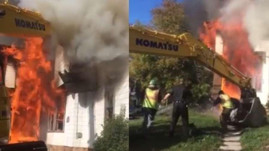 Facebook posts show the moment construction workers raised their backhoe to the second story window of a home engulfed by flames that Friday morning.