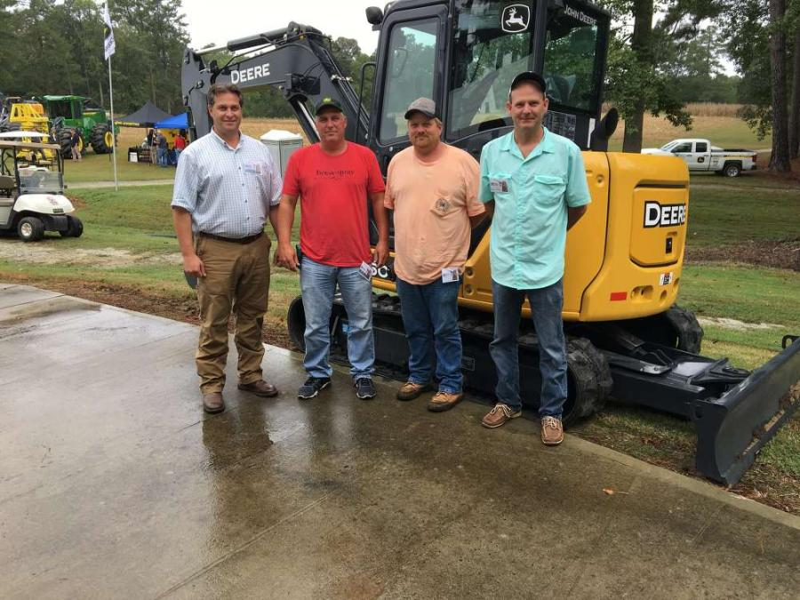 (L-R): Brian Dillenback of James River Equipment goes over the features of the excavators with Bill Sowers and Chris Prince, both of State Contractors in Wake Forrest, N.C., and Gary Gibbs of Hawthorne Development in Belmont, N.C.
